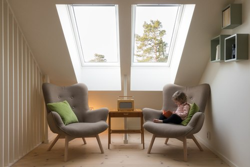 Child Reading on Furniture Illuminated by Repaired Skylight