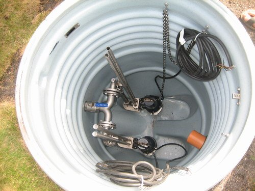 Inside of a submersible sump pump installed in a basement