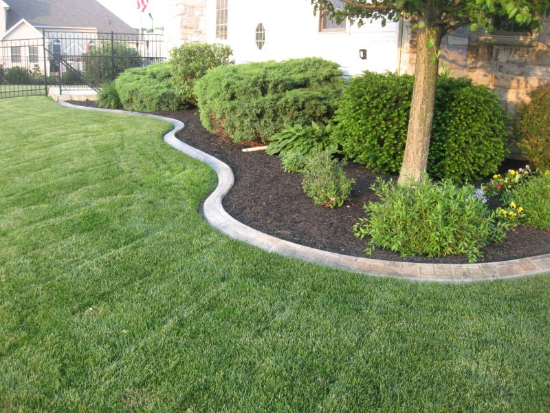 Decorative landscape curbing in mechanicsburg pa red for Red stone landscape rock