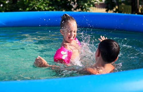 Kids having fun in an above-ground swimming pool