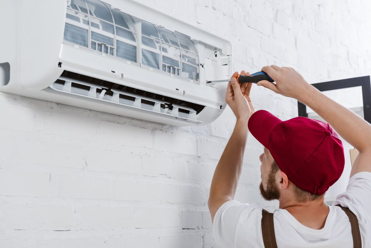 Professional checking the air filter of an air conditioner