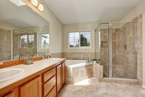 Classic bathroom design with tile flooring, tub, and shower