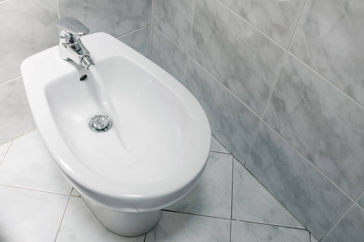 White bidet with running water top down