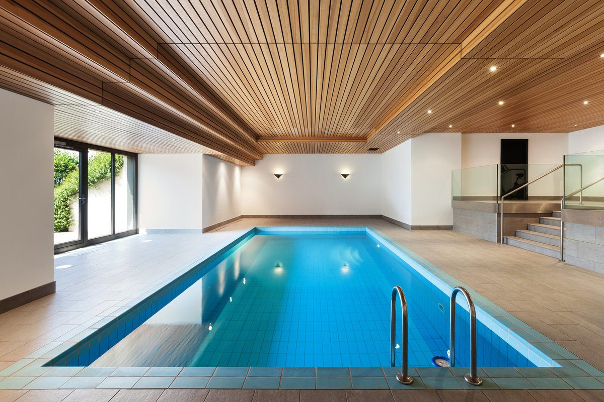 Indoor in-ground swimming pool inside a dedicated room of the house