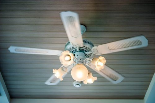 Traditional ceiling fan installed with light fixtures