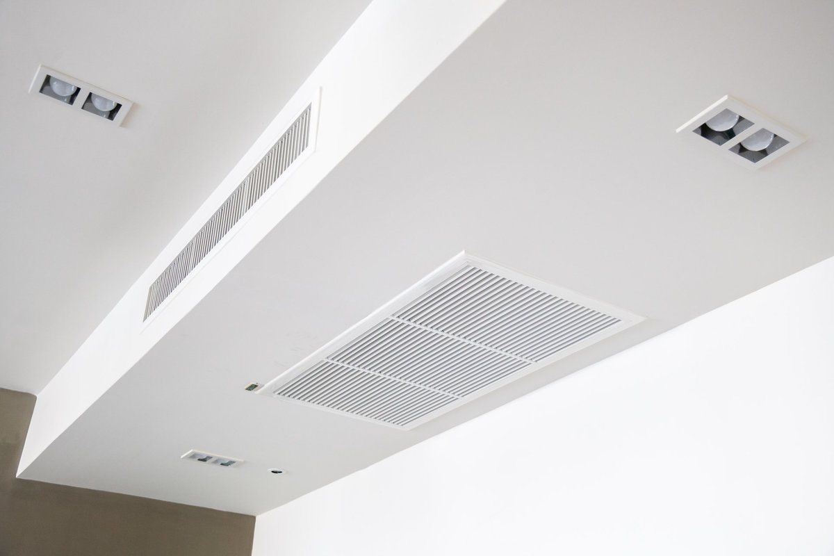 Ceiling mounted cassette type air conditioner connected to a centralized humidifier system