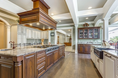 Kitchen with large island and coffered ceiling