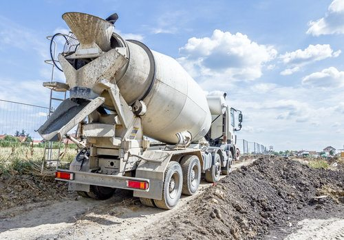 Mixer truck delivering concrete to building site