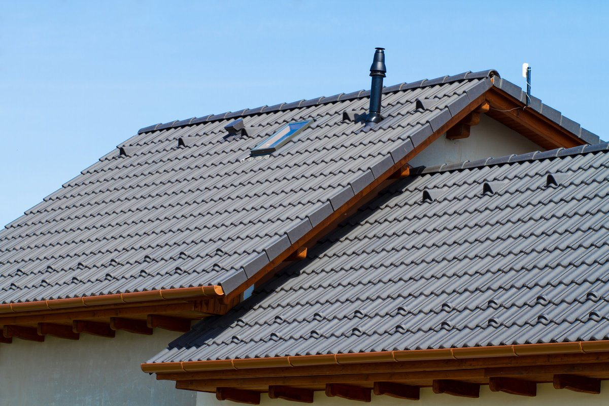 Grey concrete tile roof installed in a house