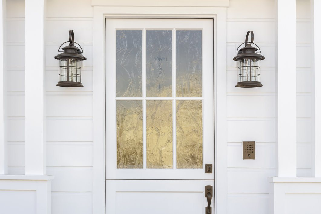 White classic front door with casing