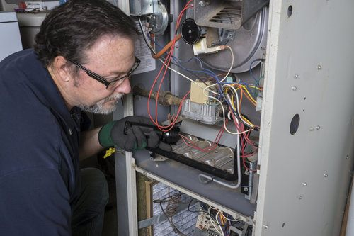 HVAC Specialist Installing Heat Exchanger of Furnace