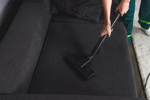 Cleaning furniture upholstery using a vacuum