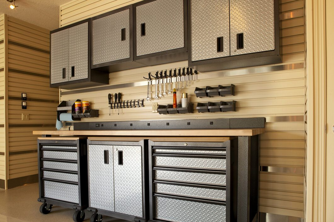 Garage workspace with cabinets, countertop and tools