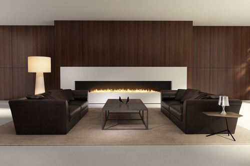 Gas fireplace in a living room with dark sofas and furniture