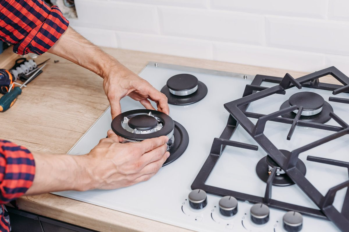 Professional repairing a gas stove