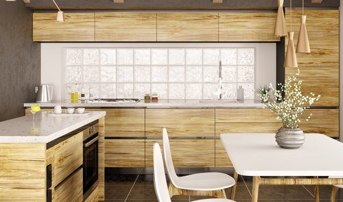 Modern interior design of wooden kitchen with glass block windows