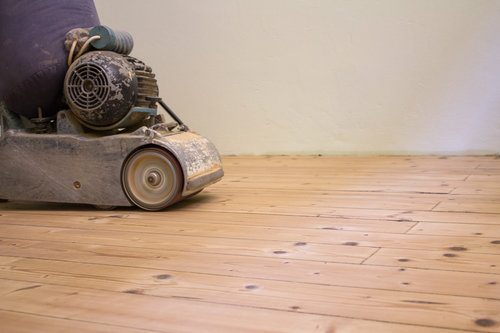 Professional sanding and refinishing hardwood floor