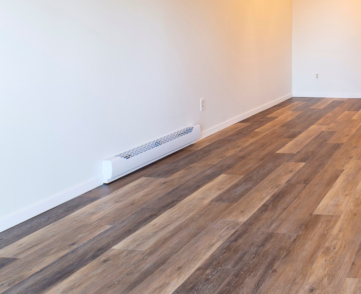 Electrical baseboard heater installed in an empty room