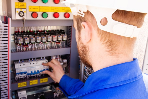 Electrician Upgrading Electrical Circuit Panel