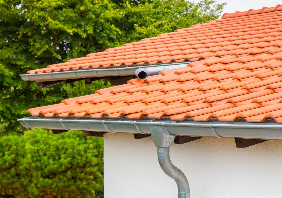 Home roof with zinc gutters installed