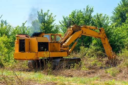 Bulldozer clearing land