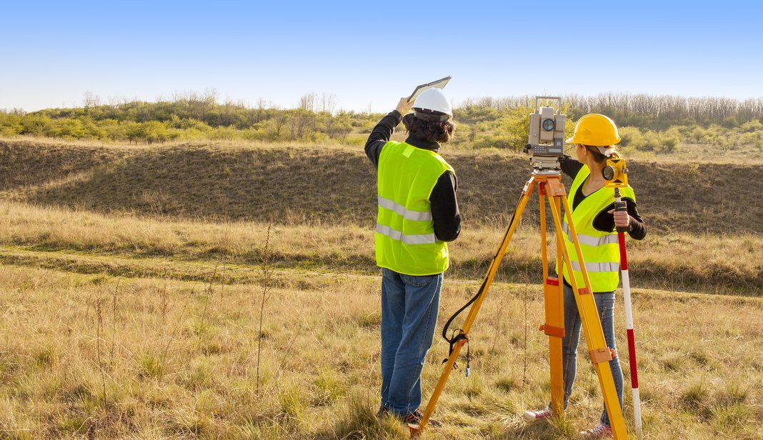 Engineers doing a land survey on a standard-sized lot