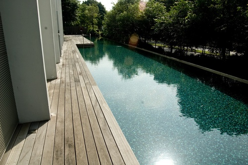 Lap pool surrounded by a wood deck