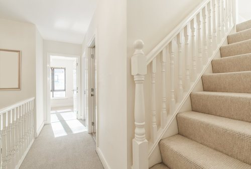 Hallway with Beige Carpet and White Painted Walls