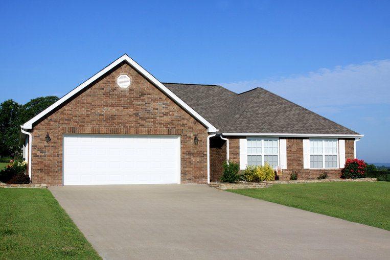 Concrete driveway of a brick home