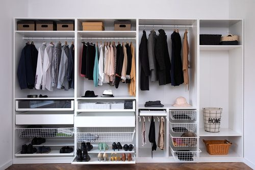 Professionally organized wardrobe in a dressing room