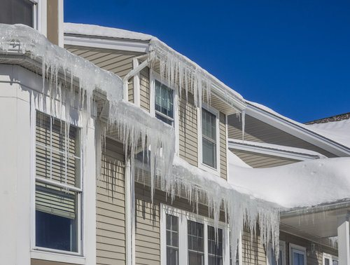Snow and ice dams on the roof of a house