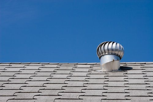 Whirlybird roof vent on roof of a commercial building