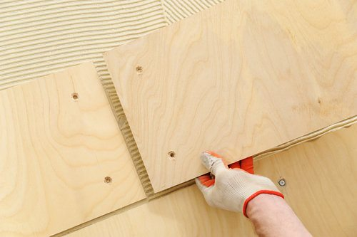 Professional laying plywood subfloor