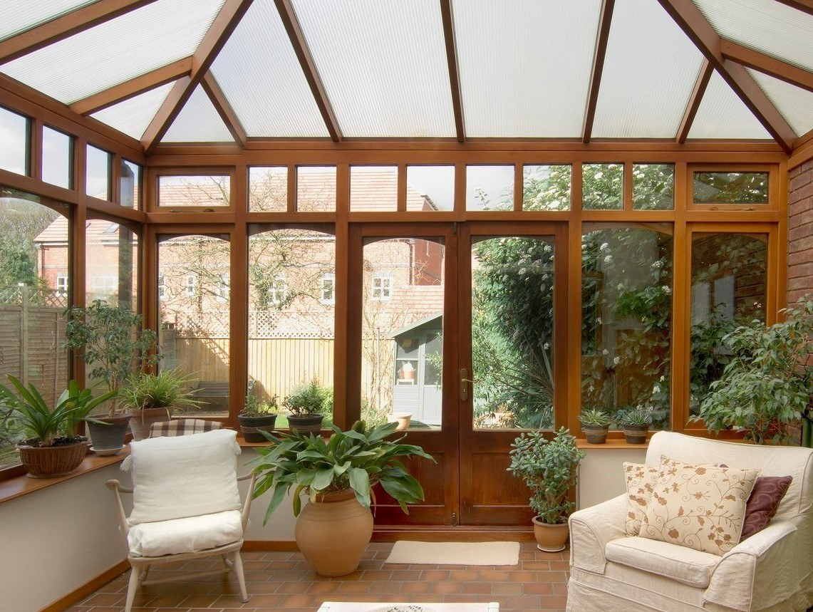 Bright sunroom with wooden structure