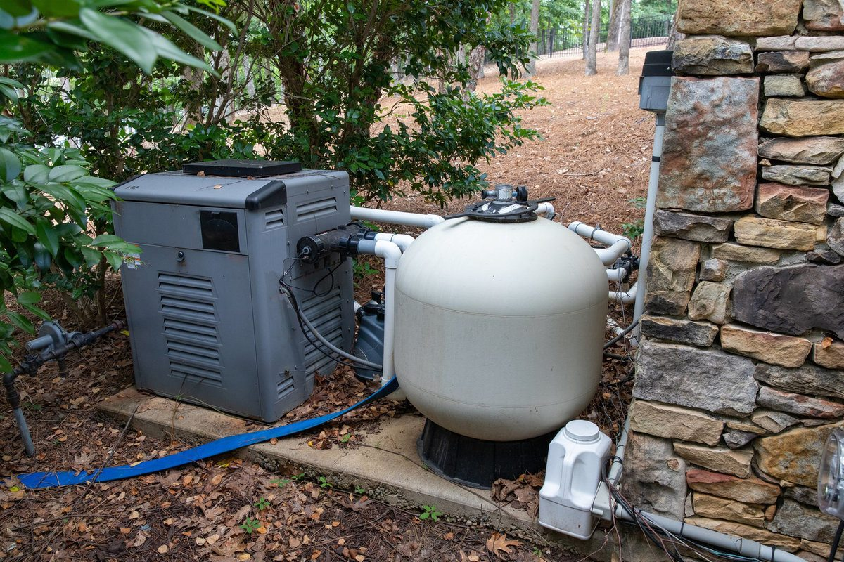 Pool Heat Pump Next to a Pool Filter