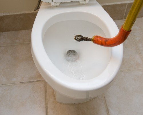 Toilet being unclogged