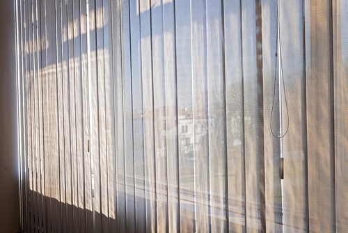 Vertical wood blinds on a sunny day