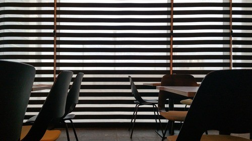 motorized wood slat window blinds installed in an office