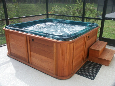 Wooden above-ground hot tub with swirling water