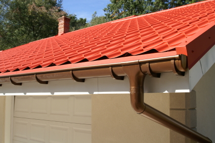 Install gutters on the roof of a house