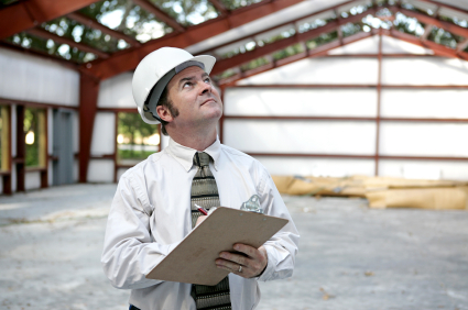 Structural Engineer with Helmet and Clipboard Ensuring the Building Stability