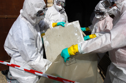 Professionals removing white asbestos from a house