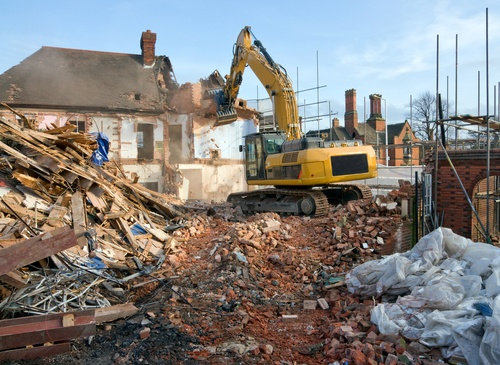Single-family house being demolished