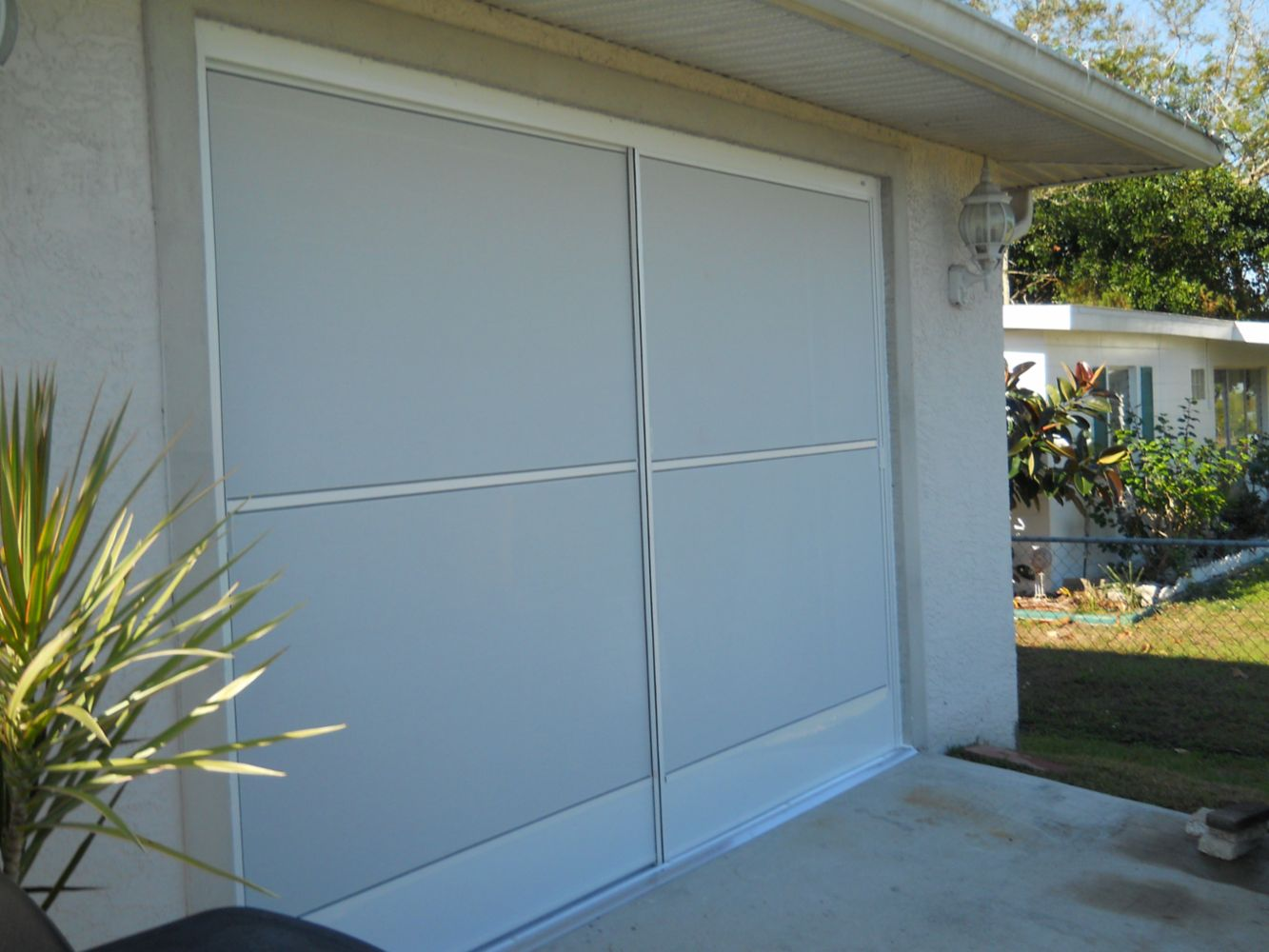 Garage Sliding Screens/ Vinyl Window Reroll in Port Charlotte, FL ...