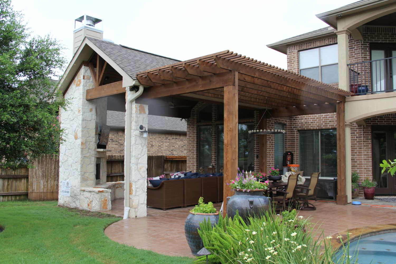 Patio covers outdoor kitchens fire features in katy tx for Outside living