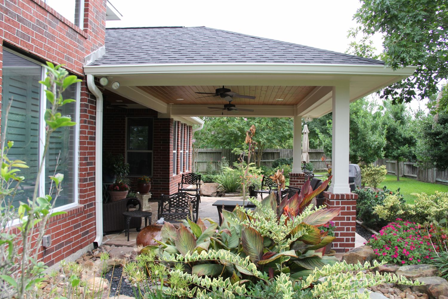 Patio covers outdoor kitchens fire features in katy tx tradition
