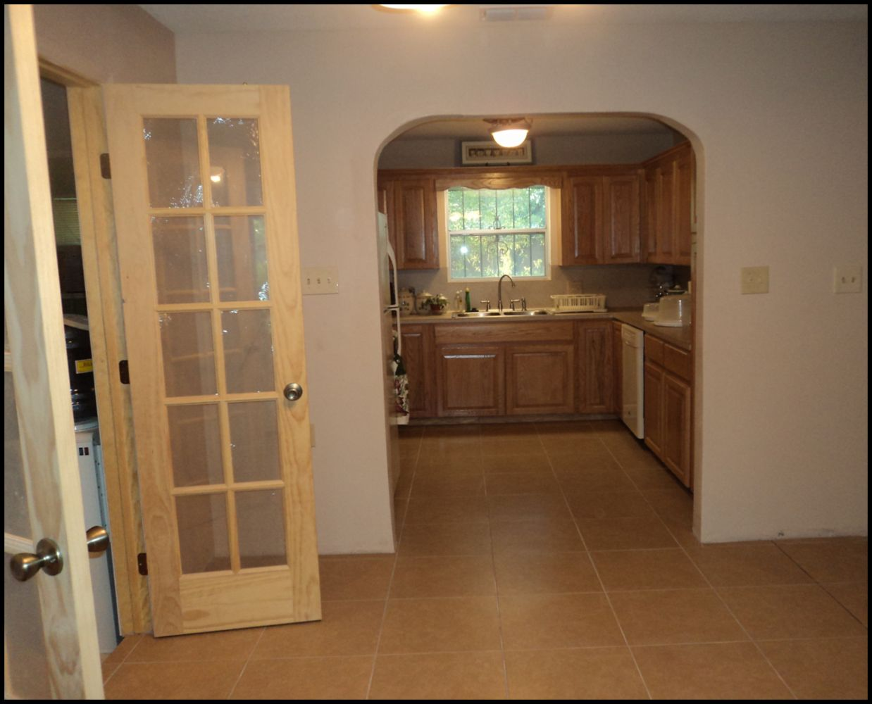 This Project Was A Kitchen Remodel By Another Cabinet Contractor. We Came  In And Made The Arch Opening And Install Ceramic Tile To The Floor.