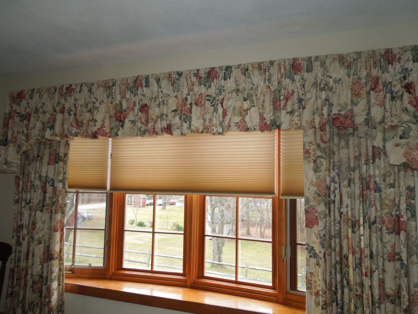 window coverings specialists in franklin ma sally s alley inc a bow window finished with hunter douglas duette architella shades