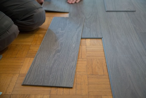 Vinyl vs laminate flooring pros cons comparisons and costs for Pvc hardwood flooring